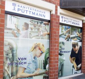 Bilder aus der Werkstatt an der Fassade des Sanitätshaus Püttmann